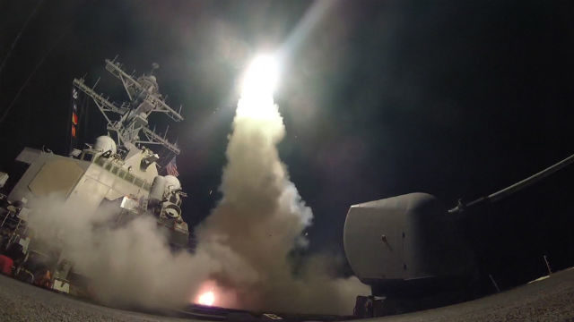 A Tomahawk cruise missile leaves the guided-missile destroyer USS Porter in the Mediterranean Sea during the strike on Syria. Navy photo