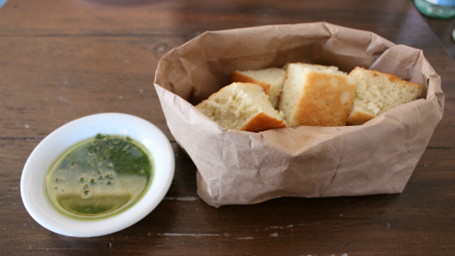 Vegan bread bowl with pesto dipping sauce. Photo by Cassia Pollock.