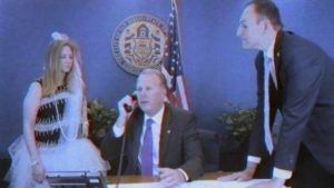 Mayor Kevin Faulconer calls Ghostbusters at urging of Barbara Bry Chief of Staff Jamie Fox (left) and Deputy Chief of Staff Matt Awbrey. Image via YouTube.com