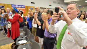Sheriff candidate Dave Myers records Tom Steyer as the audience gives him a standing ovation. Photo by Ken Stone