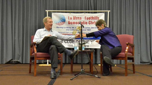 Tom Steyer takes the microphone from Diane Takvorian during a Q&A session at the La Mesa-Foothills Democratic Club. Photo by Ken Stone