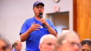Gary Burt of La Mesa asks Tom Steyer a question about San Diego homelessness. Photo by Ken Stone
