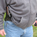 Man with concealed handgun