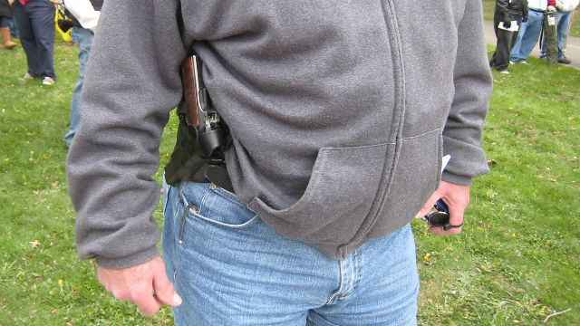 Man with concealed handgun
