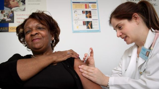 A woman receives a Hepatitis A vaccine.