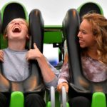 Two girls laugh during a ride in the Fun Zone at the San Diego County Fair.