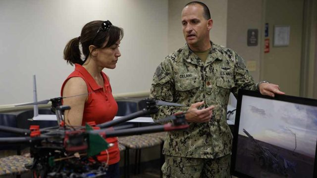 Lt. Cmdr. Jim Celani briefs Under Secretary of the Navy Janine A. Davidson on an aerial drone technology during a visit to Naval Special Warfare Command.