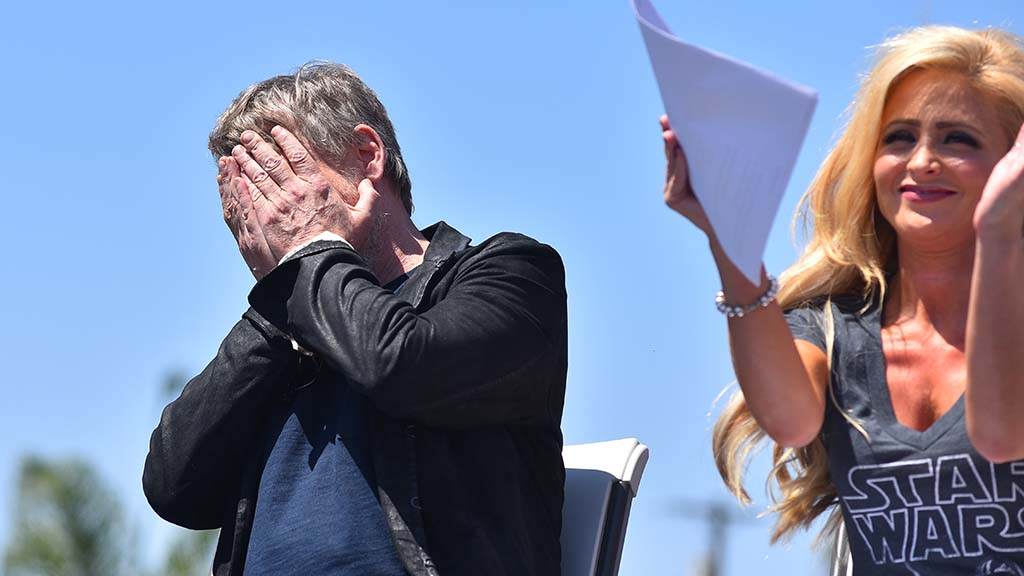 With KUSI's Lisa Remillard appluading, actor Mark Hamill reacts as a speaker announces his street sign.