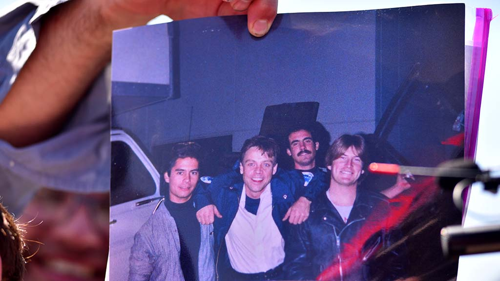 A fan holds a photo showing a younger Mark Hamill.
