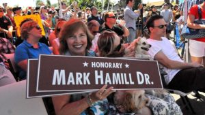Marilou Hamill, wife of Mark Hamill, holds copies of the honorary street sign.