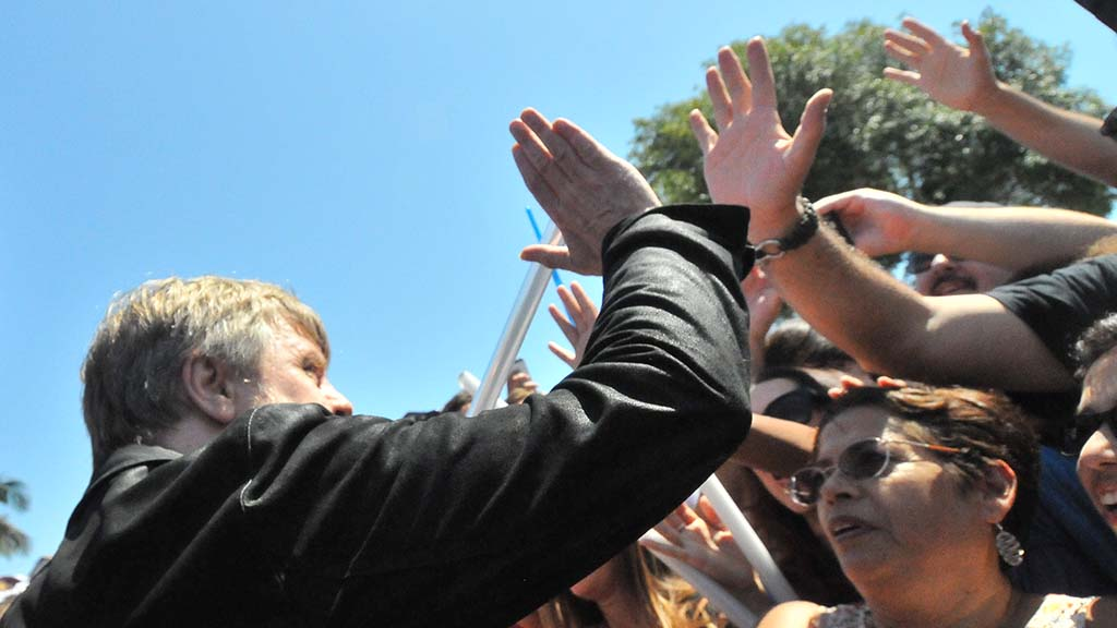 Actor Mark Hamill high-fives one of hundreds of fans who witnessed the unveiling of a street sign with his name.