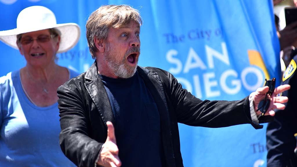 """Star Wars"" actor Mark Hamill reacts to hundreds of fans at the unveiling of an honorary street sign in his name."
