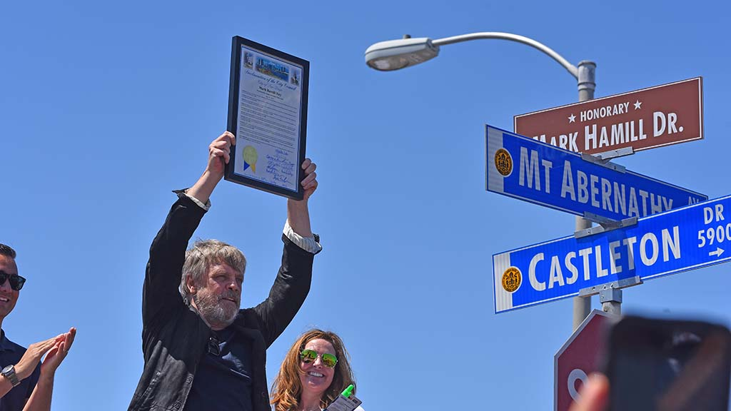 """Star Wars"" star Mark Hamill hods a proclamation making July 30 as Mark Hamill Day in San Diego."