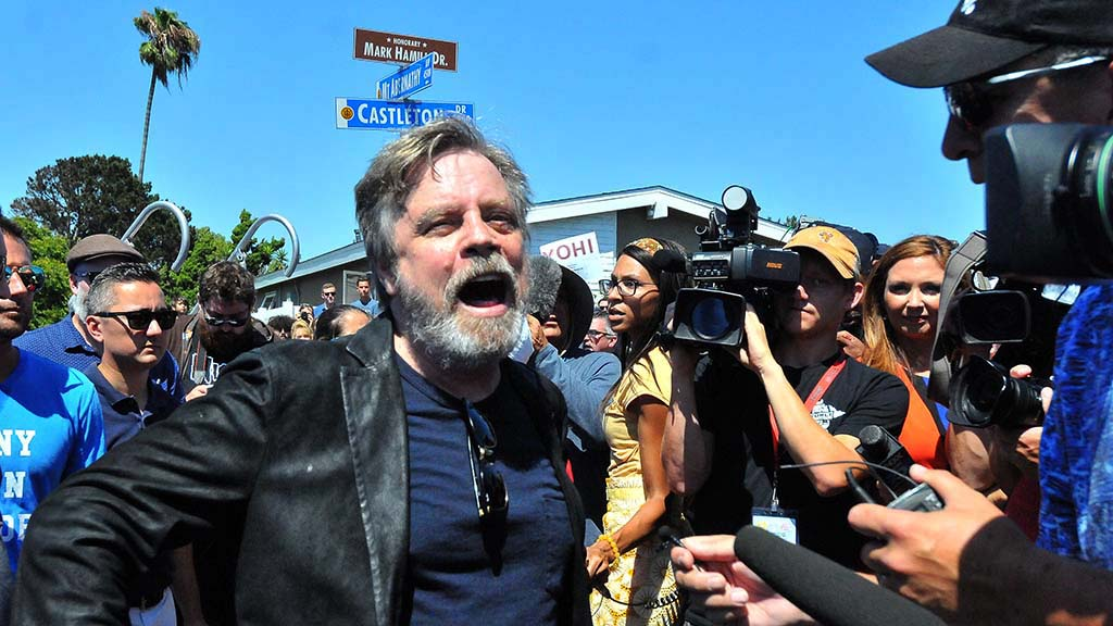 """Star Wars"" actor Mark Hamill speaks with media after the unveiling of a street sign named after him."