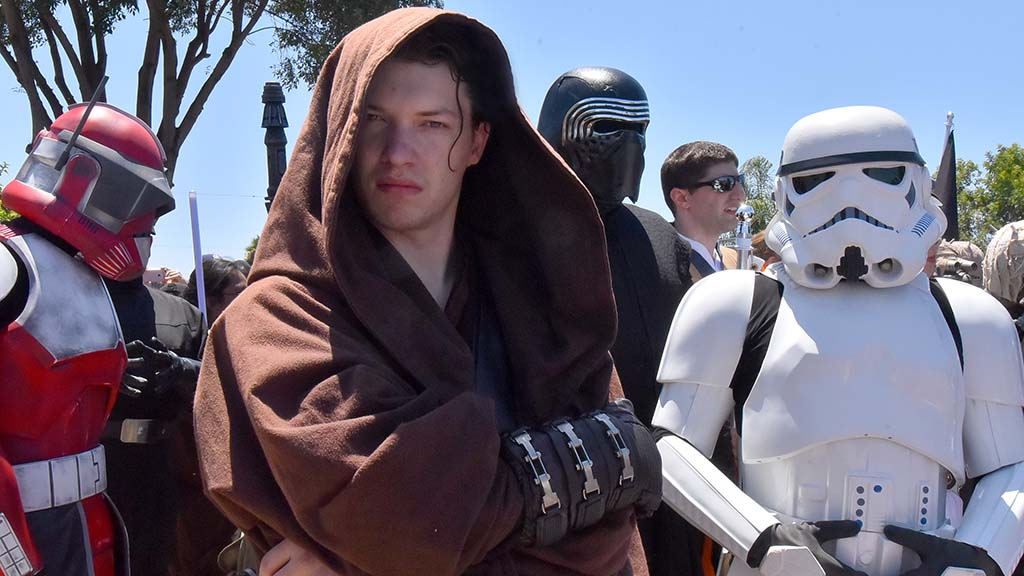 Owen Lord (second from left) of La Mesa and fellow members of 501St Legion Star Wars Costume Group greet Hamill.