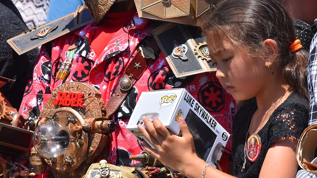 "Lala Selvern, 9, of Chula Vista, brings a ""Star Wars"" figure for an autograph."
