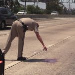 California Highway Patrol officer marks freeway accident location