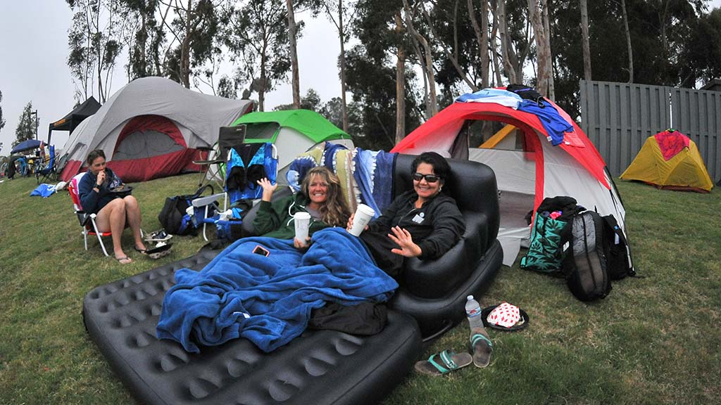 Krista Neville of Santee (left) and Martha Ornelas of Rancho Penasquitos use inflatable lounge chair in campground during their rest period.