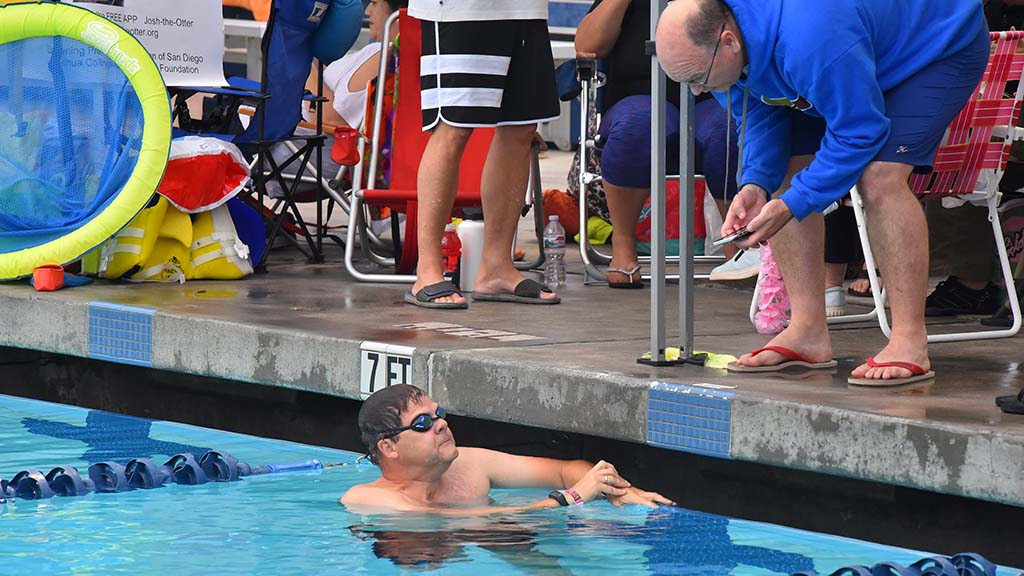 Once a swimmer finished, he or she would keep track of the next teammate's laps via the phone app. Photo by Chris Stone