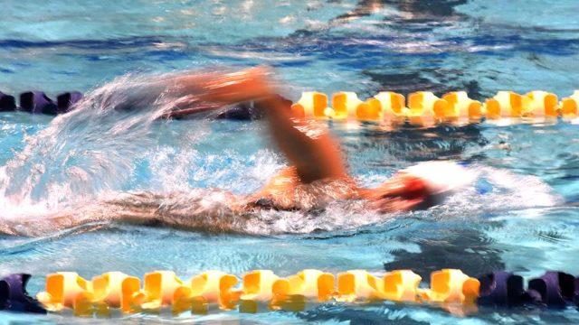 A slow shutter speed captures a painterly scene at the Swim24 Challenge.