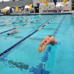 Clocks on both ends of the UCSD pool gave swimmers an idea on when to start their turns.