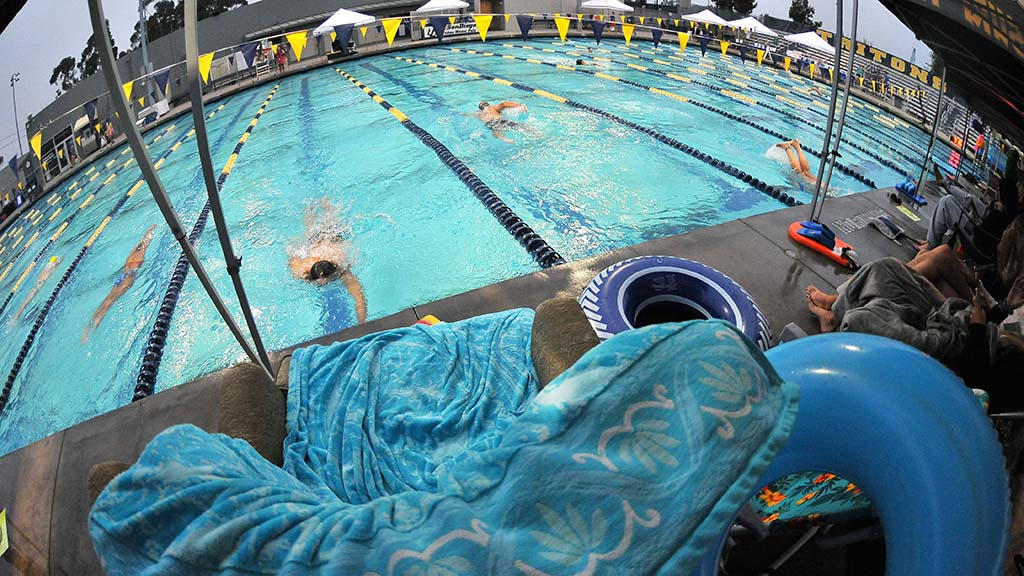 Tents along the east side of the pool were sanctuaries for team members, and 230-plus swimmers.