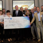 Mayor Kevin Faulconer presents check to 15 startup companies