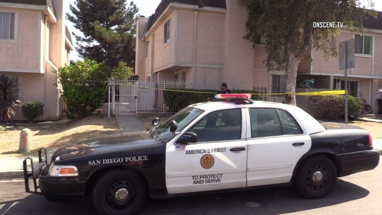 Police cruiser outside apartment