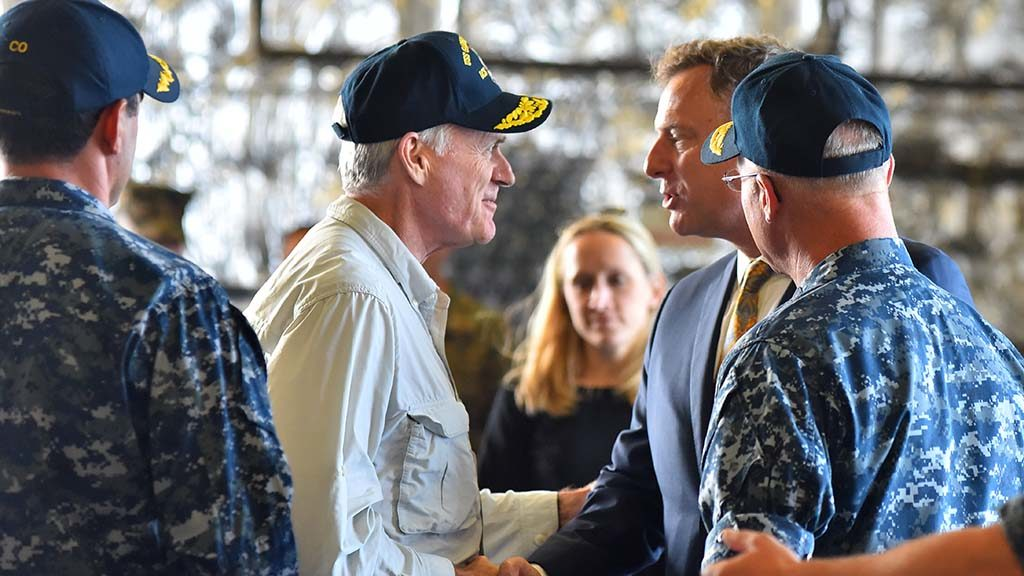 U.S. Rep. Scott Peters greets Navy Secretary Richard Spencer aboard the USS Gabrielle Giffords.