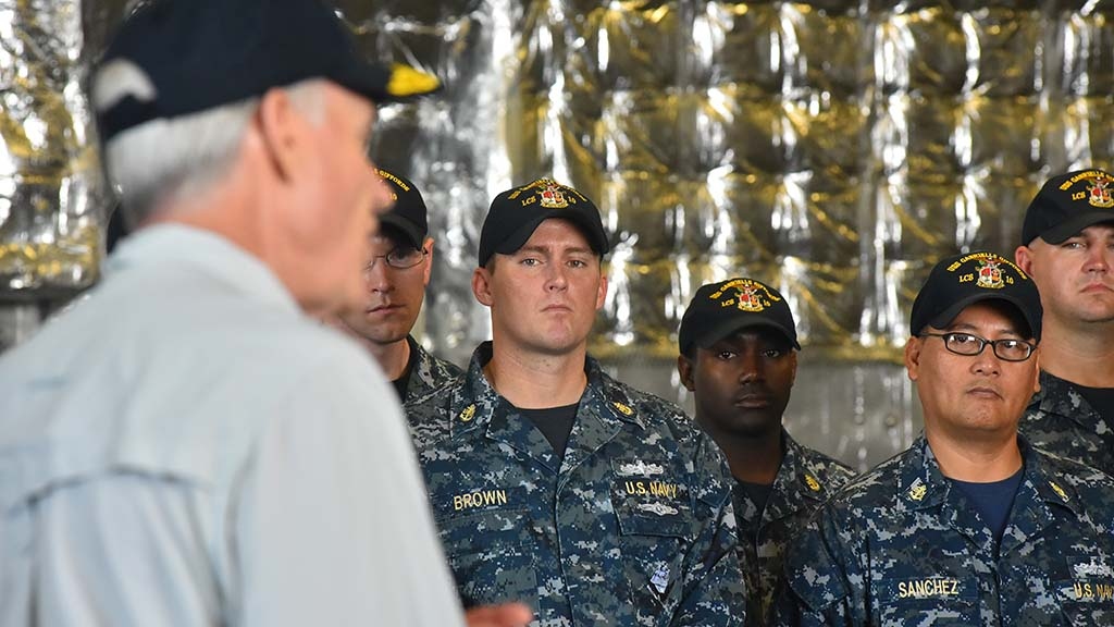 Navy Secretary Richard Spencer speaks to sailors aboard the USS Gabrielle Giffords.