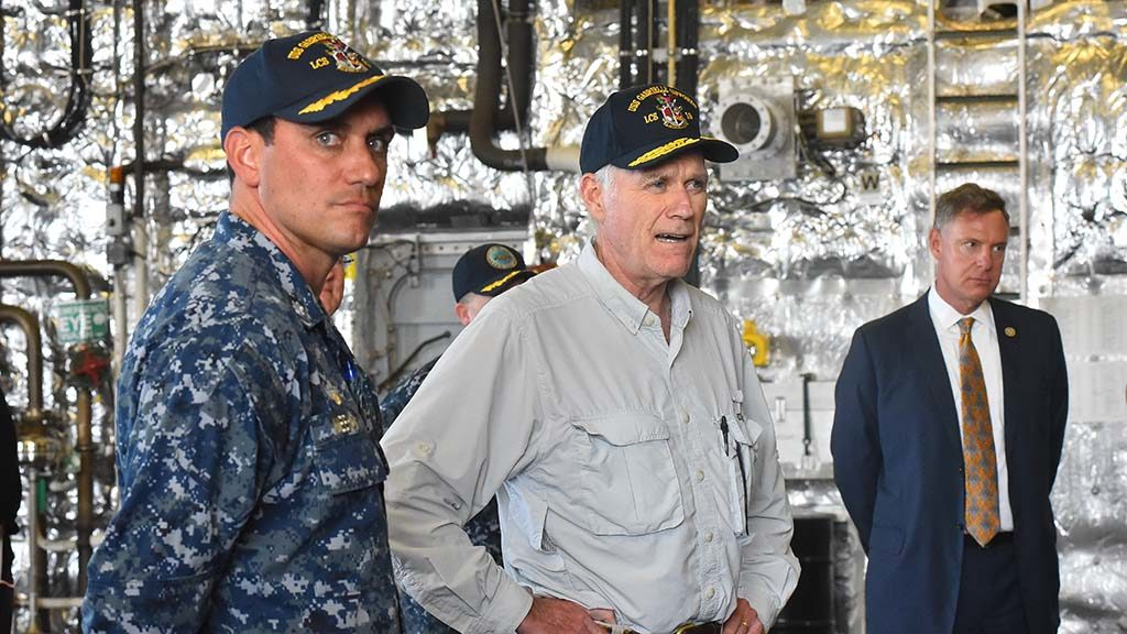 USS Gabrielle Giffords Cmdr. Kevin P. Meehan (left) gives Navy Secretary Richard Spencer and Congressmen Scott Peters a tour of the littoral combat ship.
