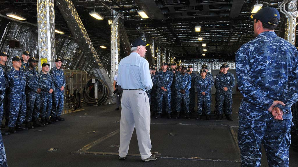 """Navy Secretary Richard Spencer speaks during an """"all hands"""" address aboard the USS Gabrielle Giffords at Naval Base San Diego."""