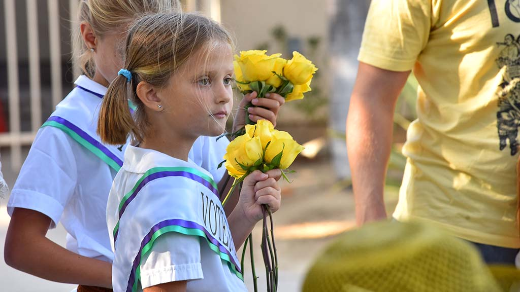 Young girls with yellow roses participate in the annual suffrage march in Balboa Park.