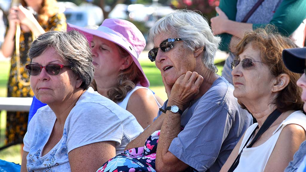 Women listen as speakers read or recite writings of suffragettes at the annual suffragette march in Balboa Park.