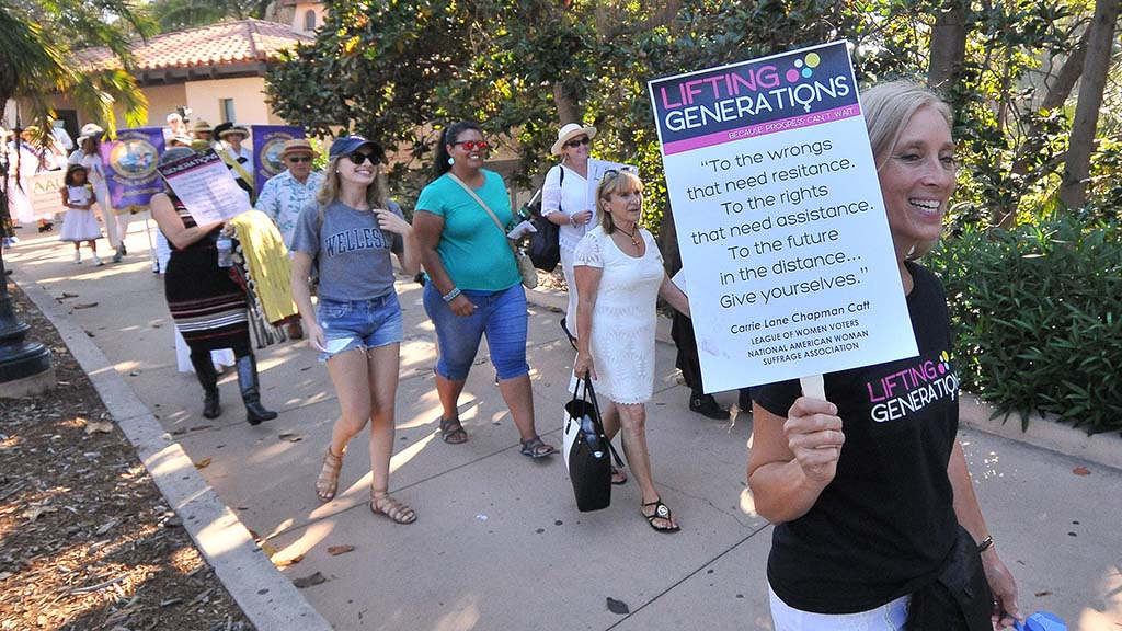 A group of about 80 people participate in the annual suffragette march in Balboa Park.