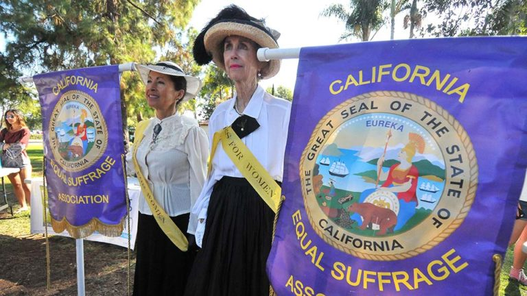 Two women represent the California Equal Suffrage Association at the annual suffragette march in Balboa Park.