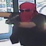 A surveillance image of the armed robber who held up Conroy's Flower Shop on July 20.