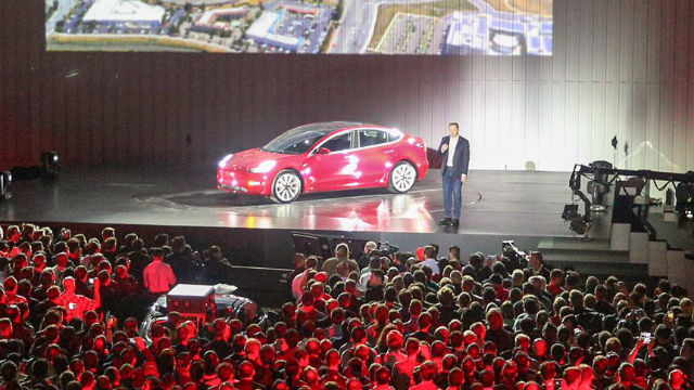 Elon Musk with the first production Tesla Model 3