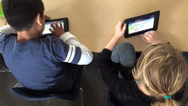 San Diego Unified School District students use student technology to take part in an Hour of Code in 2015. Courtesy San Diego Unified School District