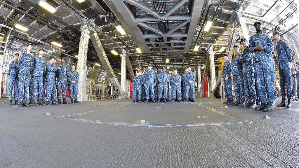 Crew members of the USS Giffords await arrival of Navy Secretary Richard Spencer.