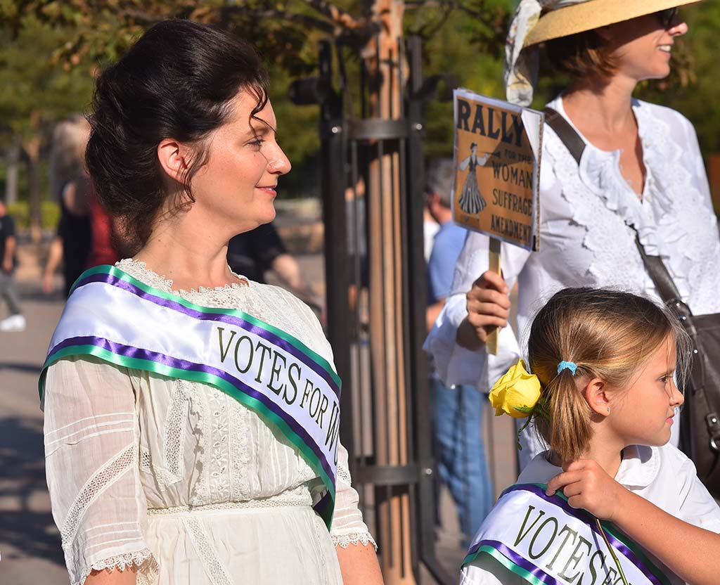 Early 20th century clothes and hairstyles were encouraged at Balboa Park march.