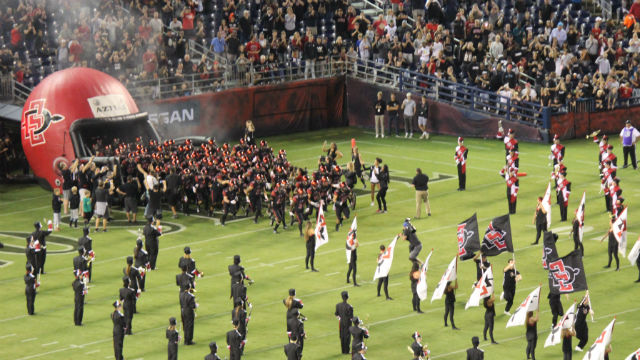SDSU football players enter the field
