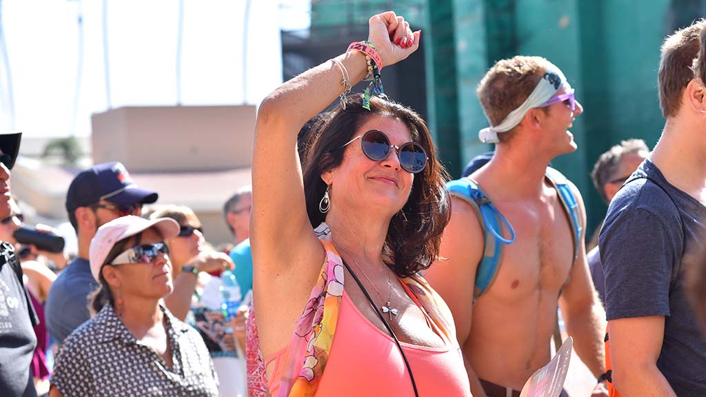 Woman gestures while enjoying the Motet at KAABOO Del Mar.