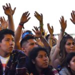 Fans wave hands at KAABOO Del Mar.