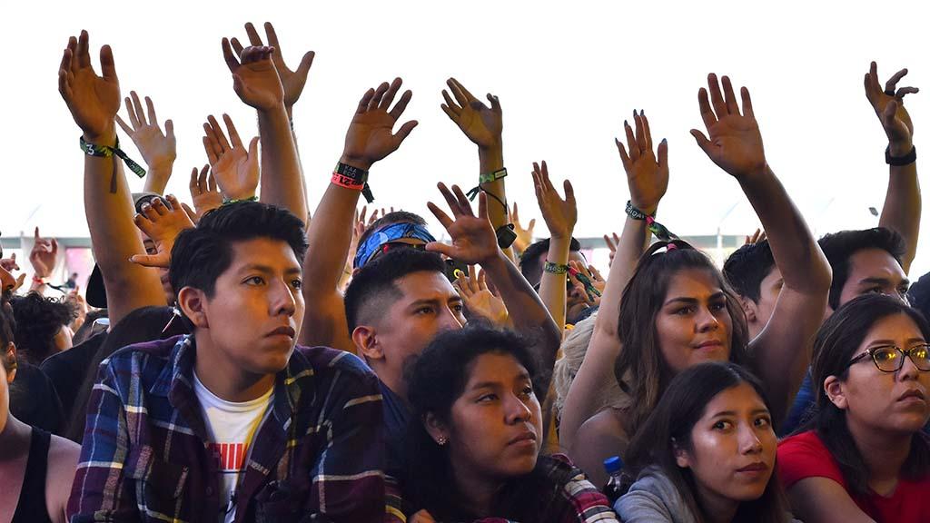 Fans wave hands at KAABOO Del Mar.