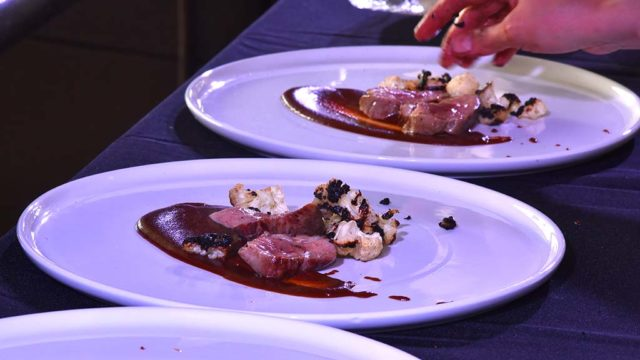 A cooking challenge pitted two chefs making dishes that were critiqued by a panel of judges.