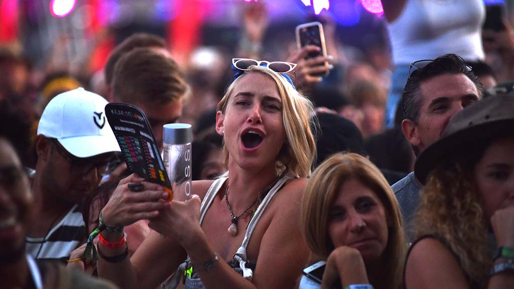 Members of the crowd react to Ice Cube's performance at KAABOO Del Mar.