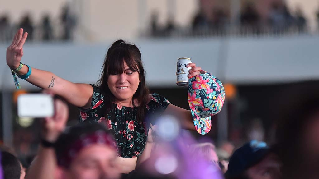 A woman enjoys Ice Cube's performance at KAABOO in Del Mar.