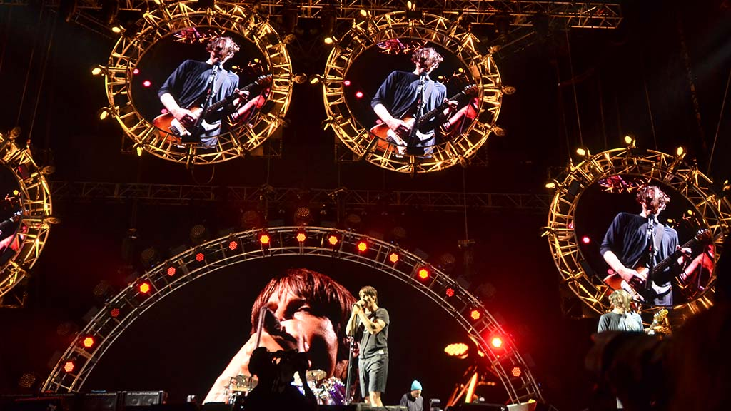 Screen behind lead singer Anthony Kiedis shows Red Hot Chili Peppers at KAABOO Del Mar.