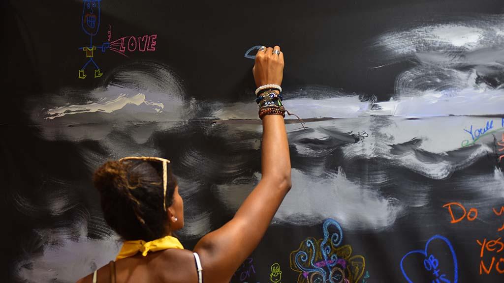P.J. Ikpe of Ocean Beach adds to the San Diego Museum of Art canvas.